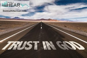Trust in God written on desert road